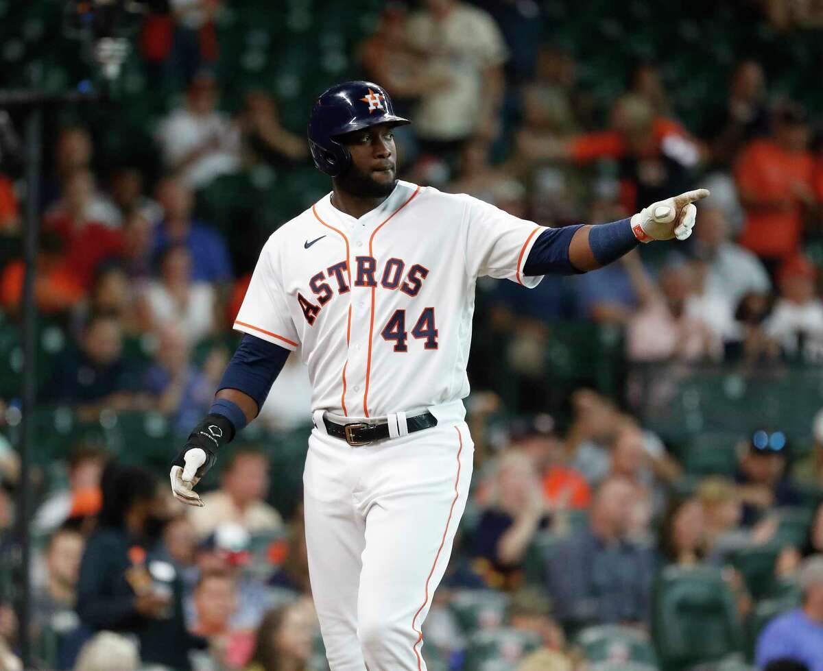 Houston Astros Yordan Alvarez (44) points to Aledmys Diaz after scoring a run on his RBI double during the third inning at Minute Maid Park, Wednesday, August 11, 2021, in Houston.