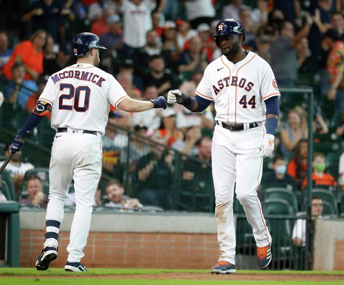 The Astros Yordan Alvarez (44) celebrates with Chas McCormick after scoring on Aledmys Diaz's RBI double during the third inning of Wednesday's 5-1 win over the Rockies at Minute Maid Park.