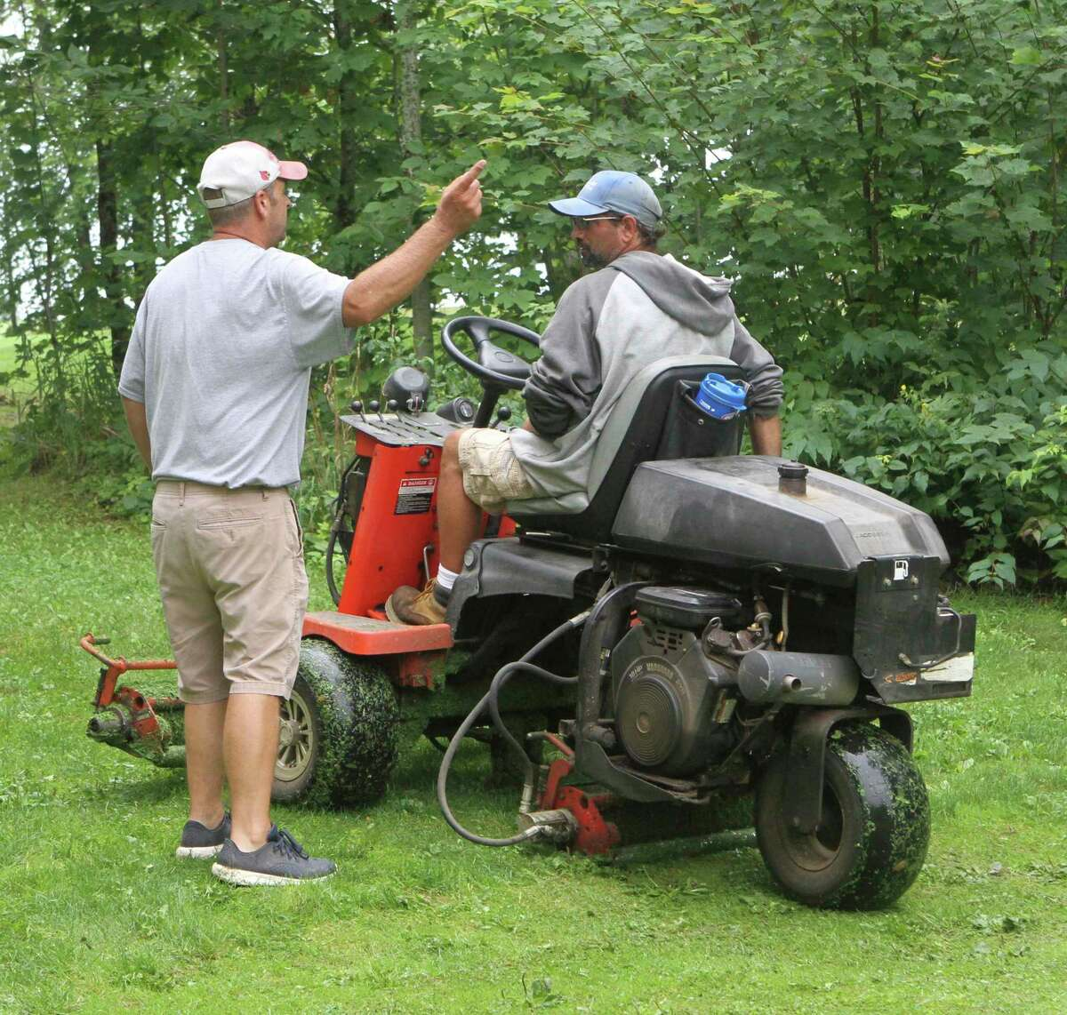 Currie instructs one of his groundskeepers during on Tuesday morning. (Pioneer photo/Joe Judd)