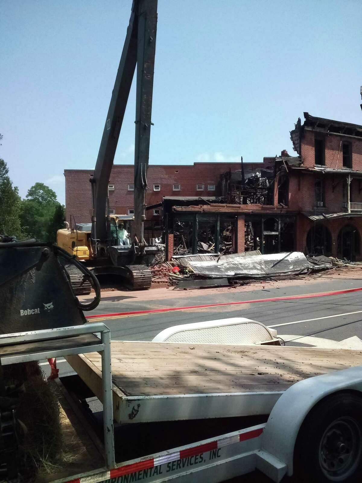 The New Hartford House was demolished Wednesday after it was severely damaged by a three-alarm fire.