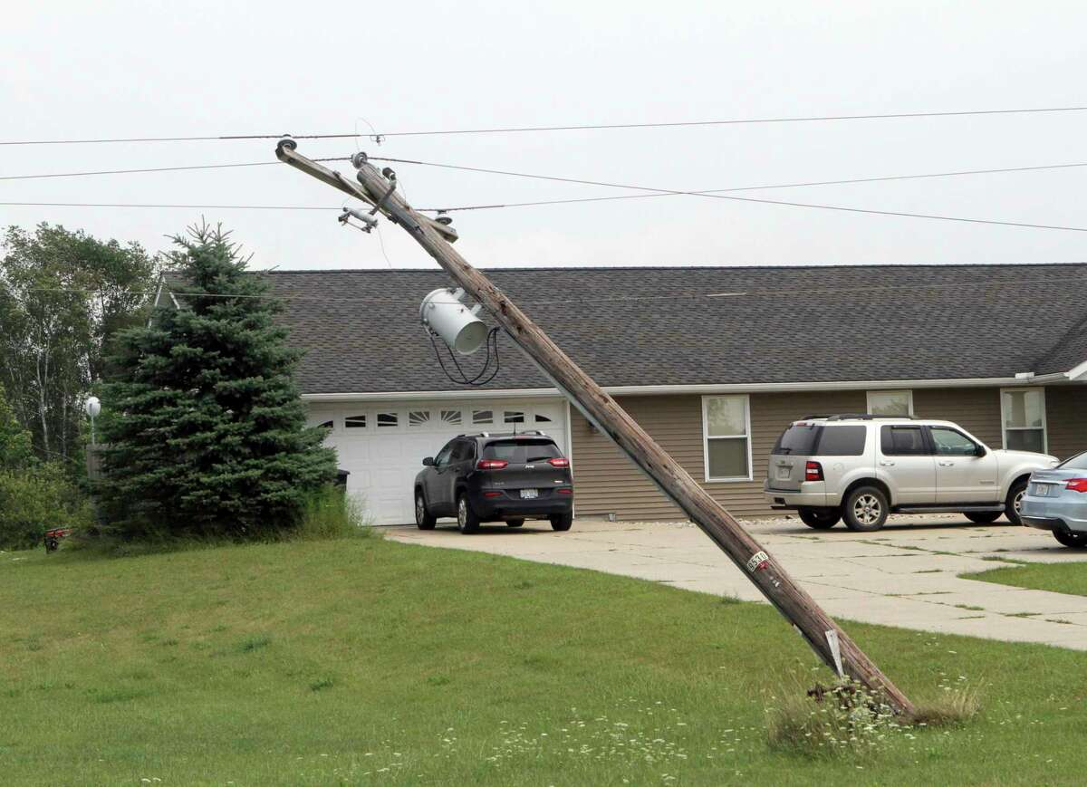 An electric pole five miles outside of Remus remains bent backward after Tuesday night's storm. (Pioneer photo/Joe Judd)
