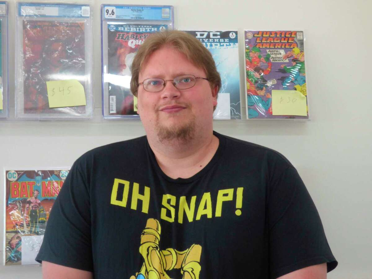 Greg Hiltz, owner of Rebel's Sanctuary, will be handing out free comic books from his store in Manistee on Saturday. (File Photo)