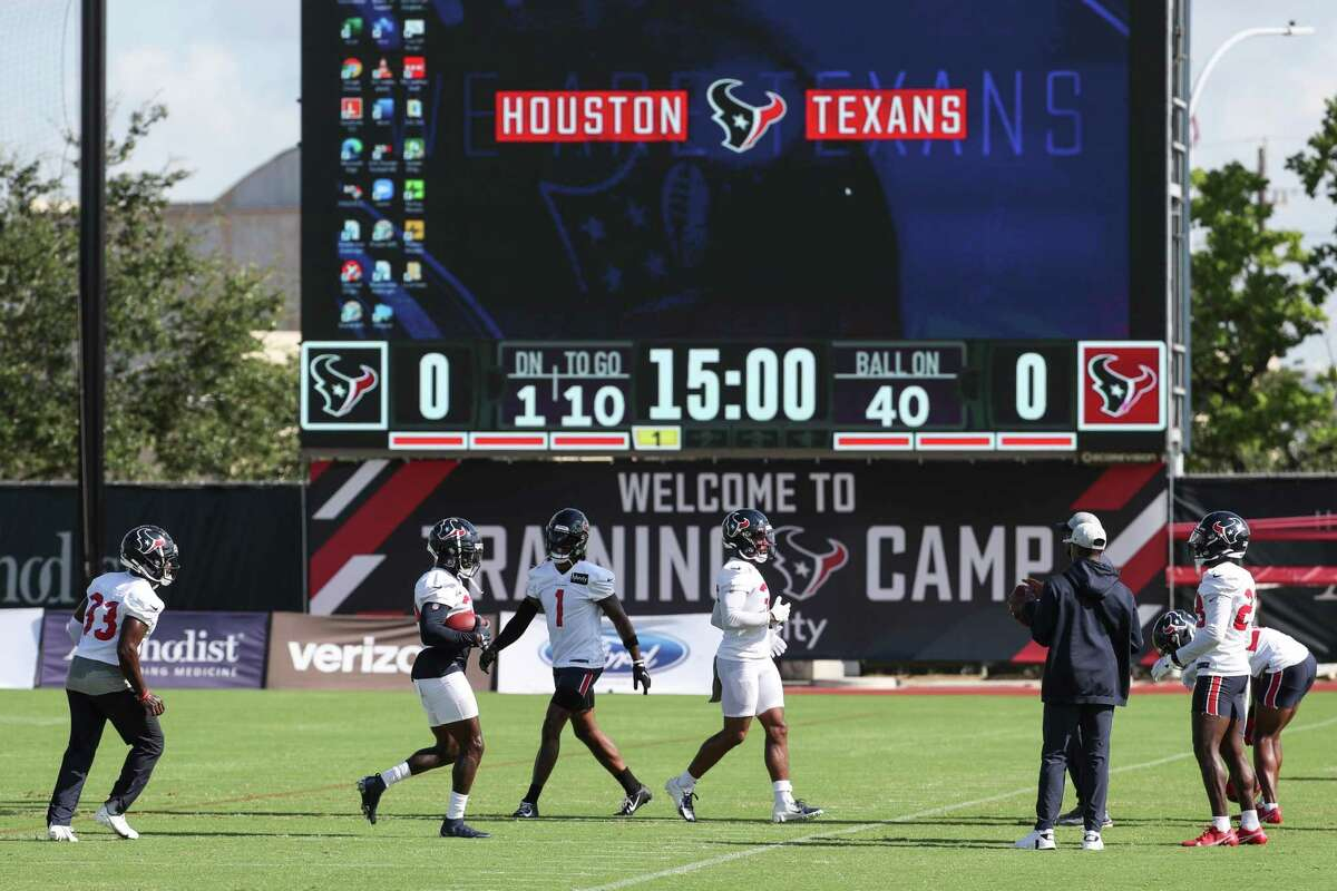 Houston Texans defensive backs run drills during an NFL training camp football practice Wednesday, Aug. 11, 2021, in Houston.