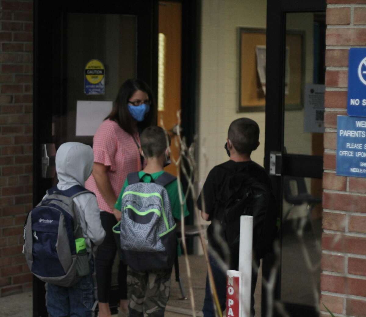 In this file photo, Kaleva Norman Dickson Schools students enter the building on the first day of school, Sept. 8, 2020.