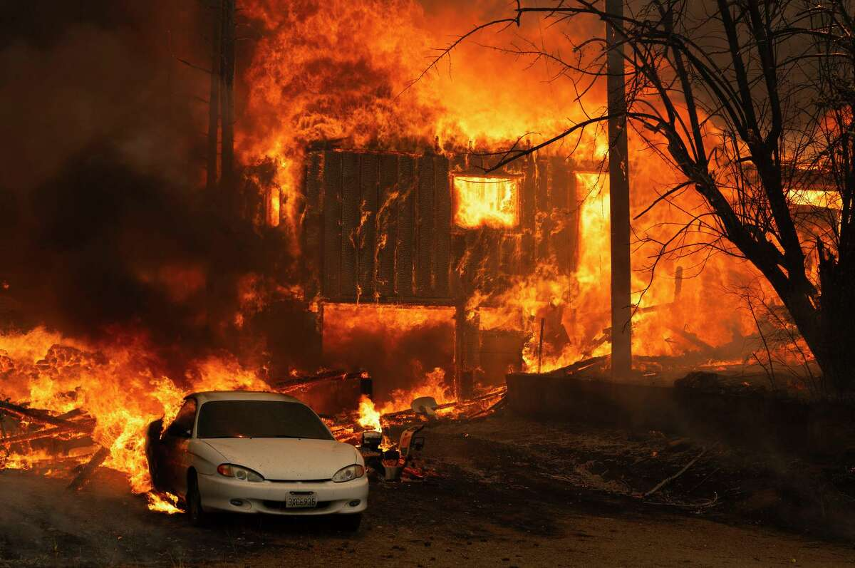 A home burns on Highway 89 south of Greenville, California, near Forgay Road during the Dixie fire on Aug. 5.