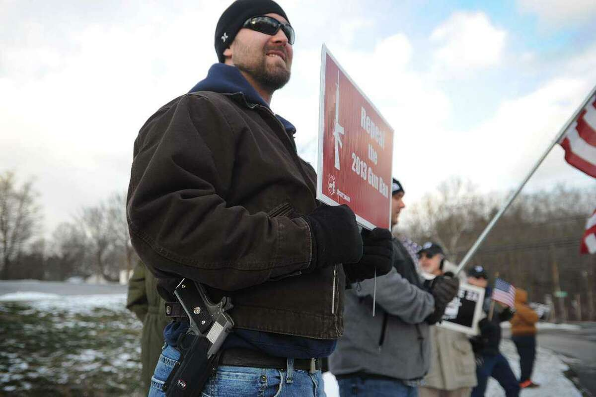 File photo. Robert Harris, of Old Saybrook, open carries as he and fellow gun rights advocates oppose a gun control rally outside the National Shooting Sports Foundation's headquarters in Newtown, Conn. on Monday, January 18, 2016.