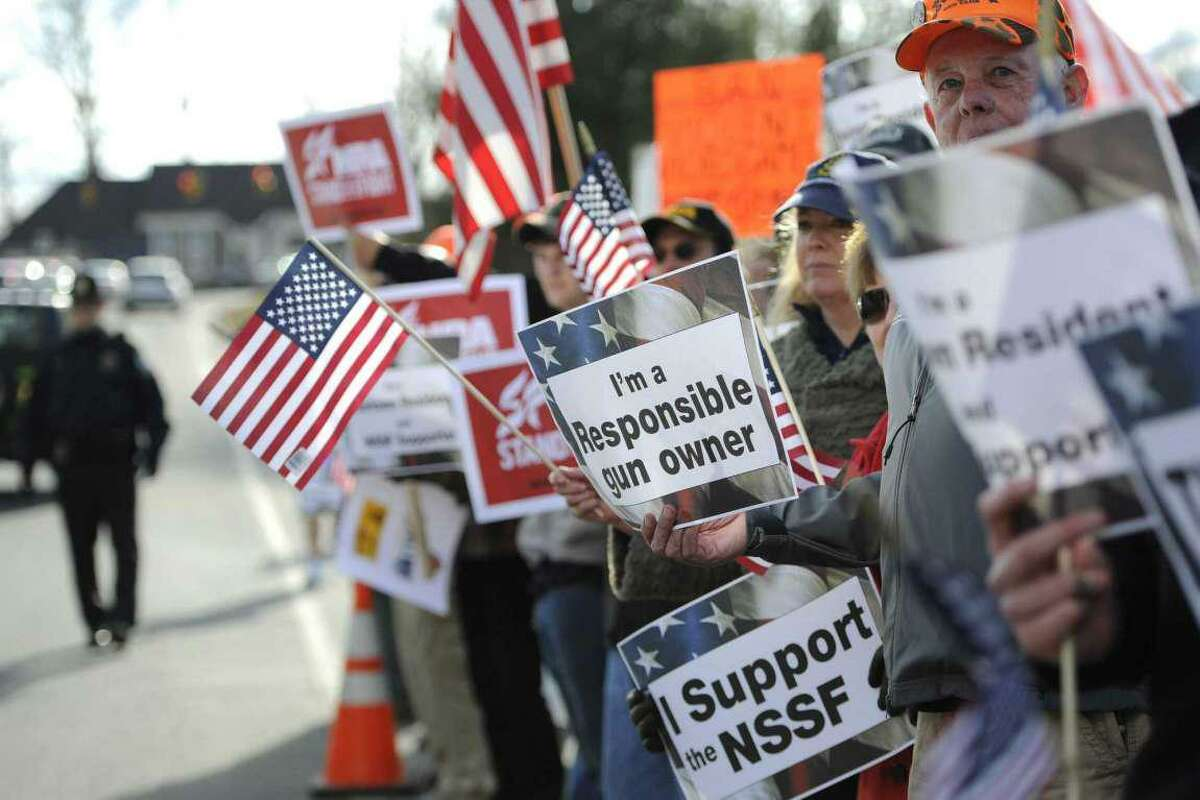File photo. Supporters for gun rights gather outside the National Shooting Sports Foundation headquarters in Newtown, Conn., Thursday, March 28, 2013.