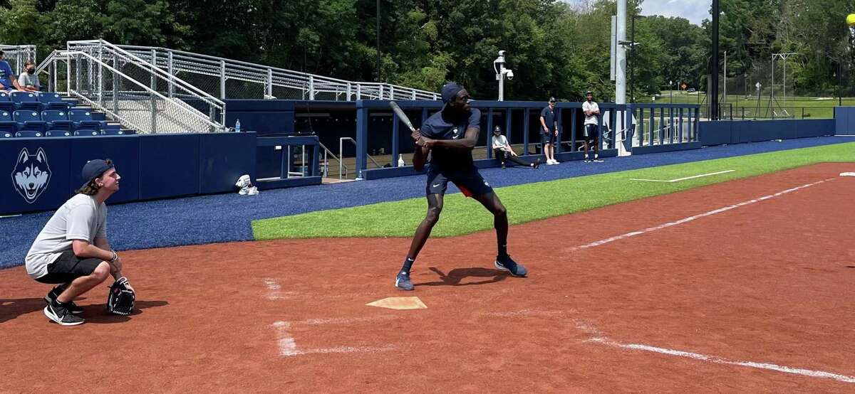 UConn junior Akok Akok takes an at-bat during the Huskies recreational softball game Wednesday at Burrill Family Field.