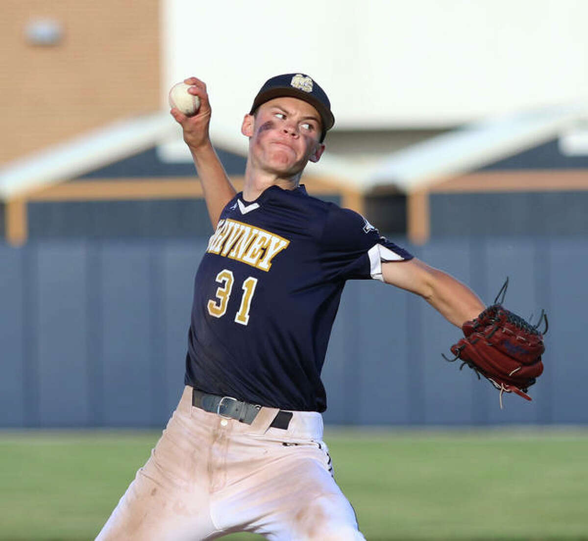 Father McGivney sophomore Jackson Rodgers delivers a pitch to the plate during his scoreless seventh inning of relief to finish off the Griffins' win over Metro-East Lutheran for a Class 1A regional title in Glen Carbon. Rodgers is the 2021 Telegraph Small-Schools Baseball Player of the Year.