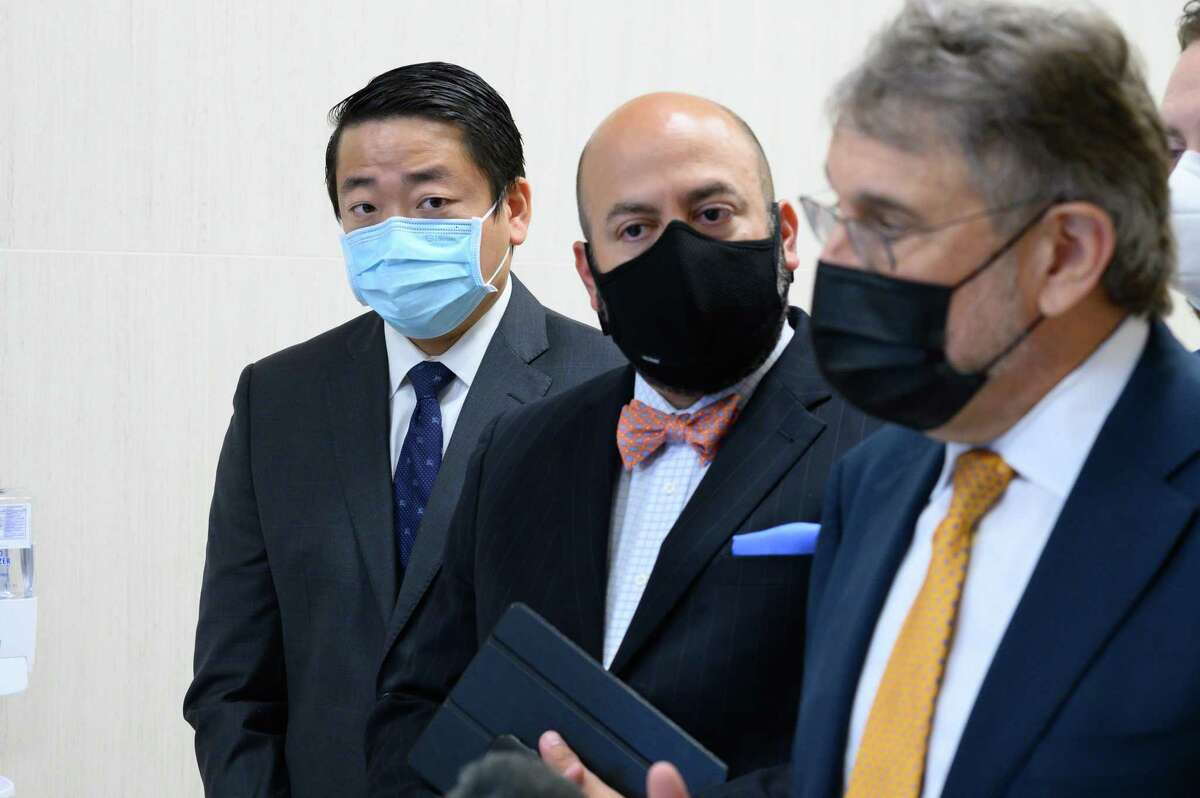 State Rep. Gene Wu listens as his lawyers speak following an appearance at the Harris County Courthouse on Wednesday, Aug. 11, 2021. State District Judge Chris Morton granted a writ of habeas corpus for State Rep. Gene Wu, pre-empting a civil arrest warrant for his absence in the Texas Legislature.