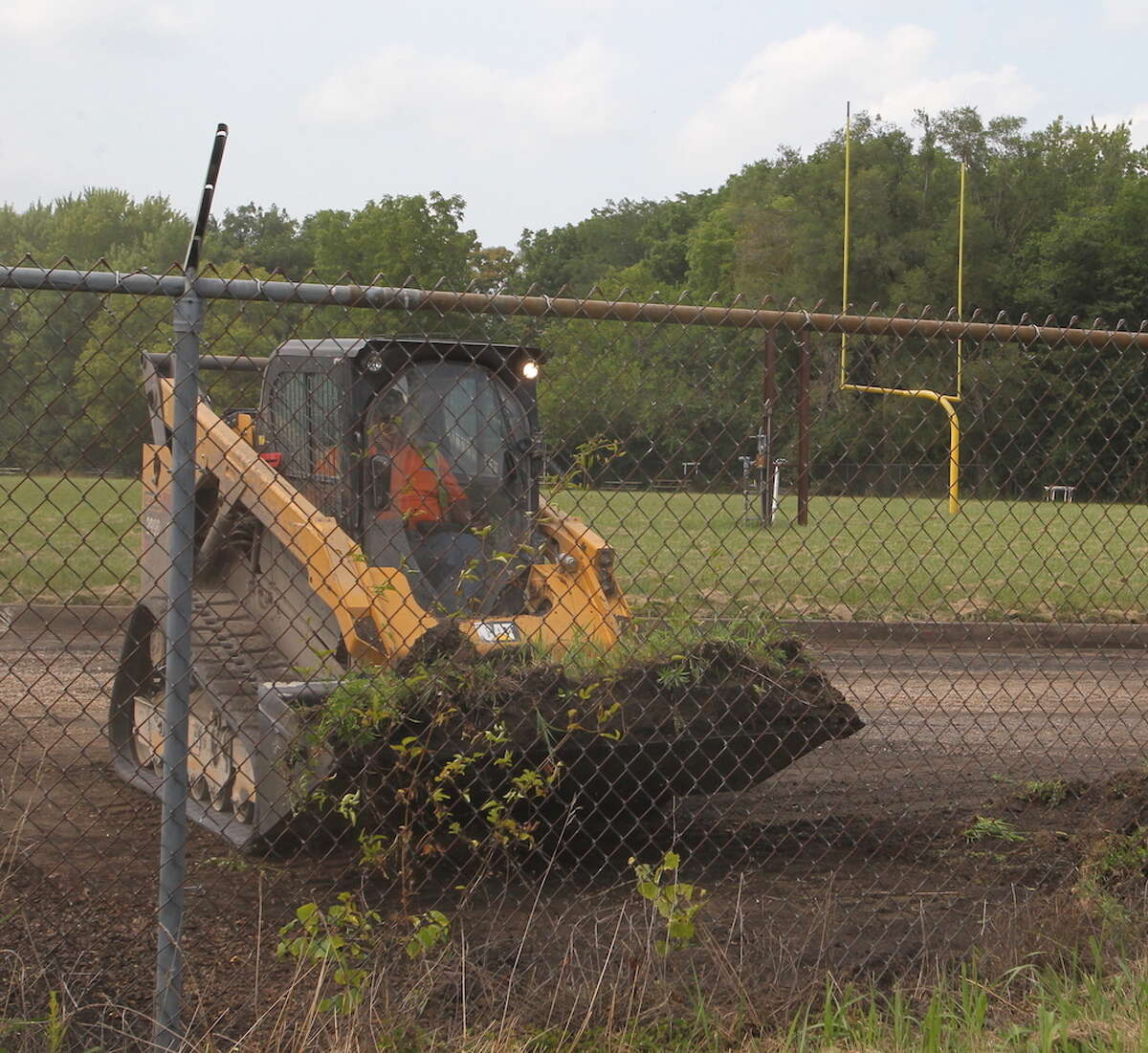 A cinder track, long buried under a layer of dirt and weeds, is getting new life for Our Saviour School and Routt Catholic High School athletes.