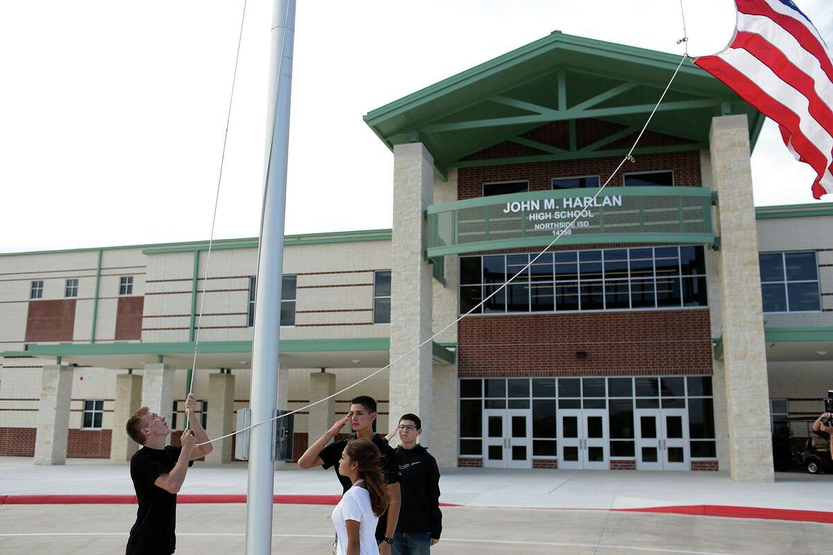 JROTC cadets raise the flag on the first day of classes in 2017 at the then-new Harlan High School in Northside ISD. The school district is playing for time, delaying a decision on a mask requirement as local and state officials fight it out in court.
