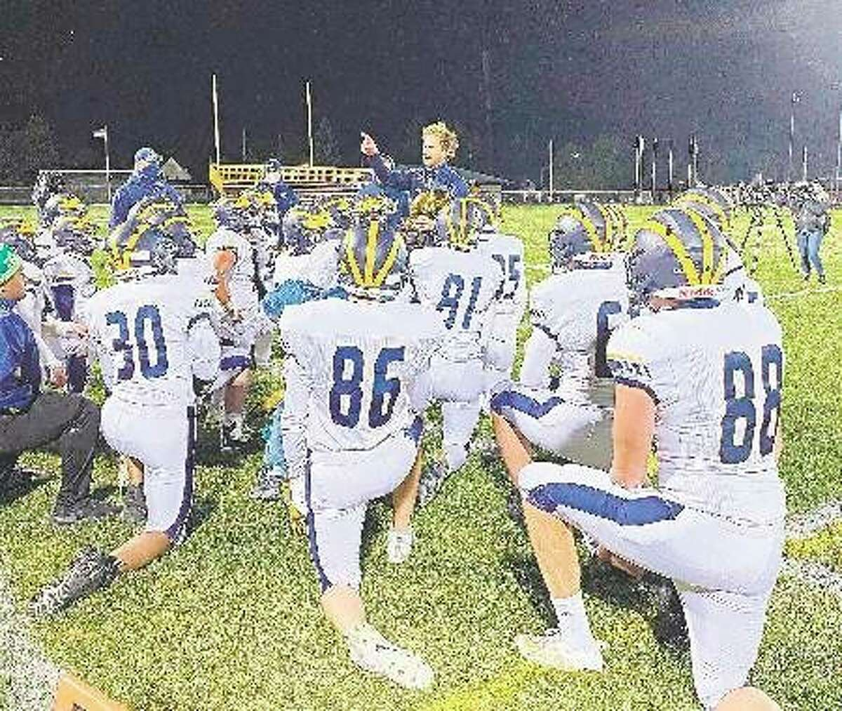 Manistee football coach Troy Bytworkaddress his team after a victory over Ludington last season. On Tuesday, Manistee Area Public Schools reported three positive cases of COVID-19 on the team; practice started on Monday. (File photo)