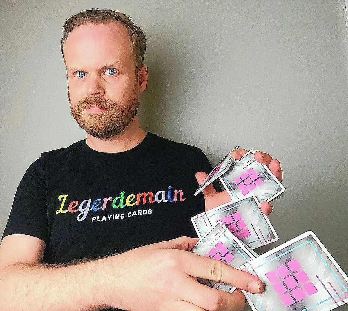 """Jacksonville High School graduate Andrew Coats, 32, has formed a playing card company that helps artists use cards as a platform for their work. Coats' business, Legerdemain, is part of Cardistry - """"card"""" and """"artistry"""" - which is the art of moving cards, and tricks, with hands."""