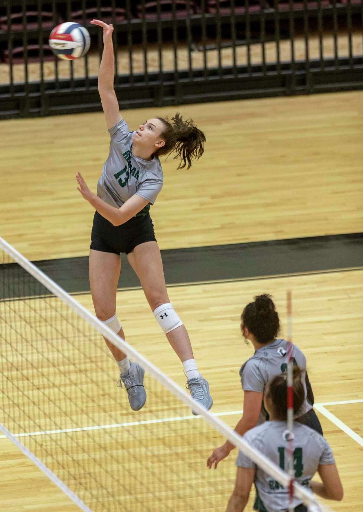 Reagan's Katie Hill hits the ball Tuesday, Aug. 10, 2021 at Littleton Gym during the Rattlers' game against O'Connor.