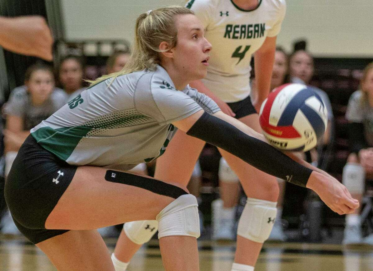 Reagan's Jenna Karleskint digs for the ball Tuesday, Aug. 10, 2021 at Littleton Gym during the Rattlers' game against O'Connor.