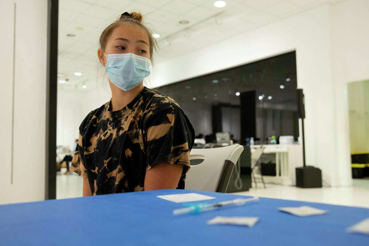 Madelyn Williams, 18, an incoming UC Berkeley freshman, waits to get a Johnson and Johnson Covid-19 vaccine at a vaccination site in Fairfield, Calif.