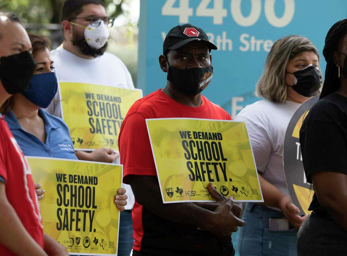 Representatives from eight school districts ask HISD to require masks as students are going back to school during a press conference Wednesday, Aug. 11, 2021, outside Hattie Mae White Educational Support Center in Houston.