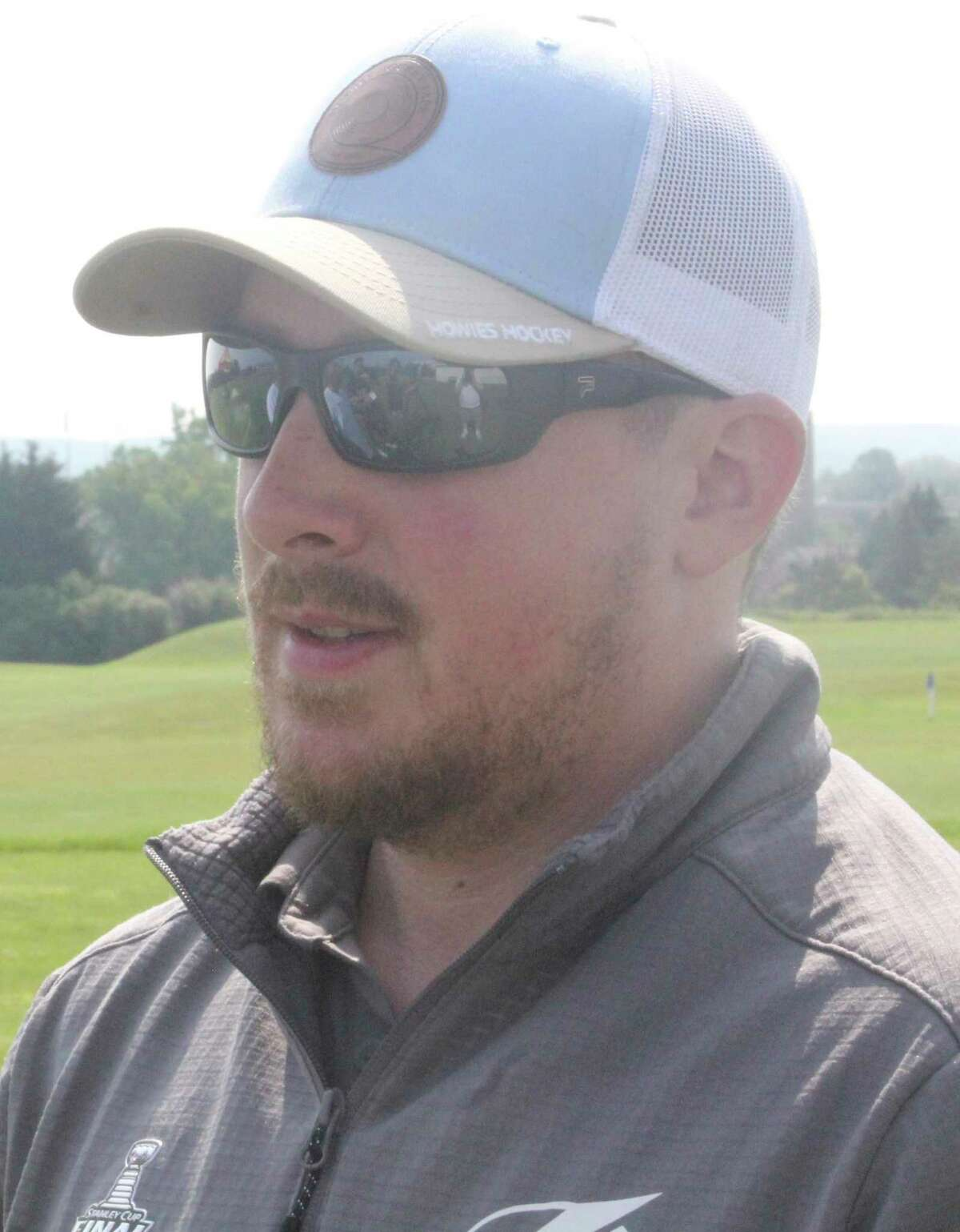 Big Rapids native and current Tampa Bay Lightning video coordinator Brian Garlock answers questions from reporters on Saturday at the Ferris State hockey golf outing. (Pioneer photo/John Raffel)