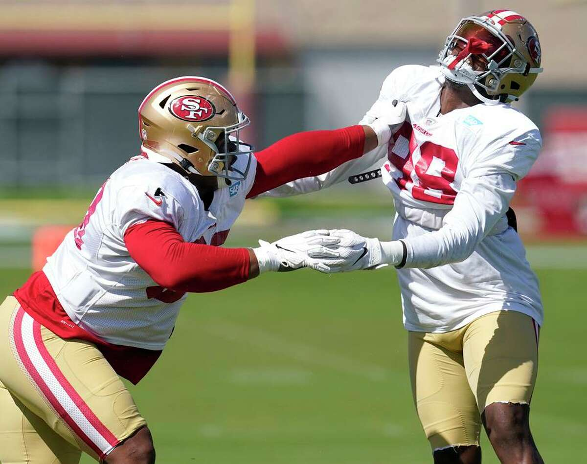San Francisco 49ers defensive tackle Arden Key, right, performs a drill with Kevin Givens during training camp Tuesday in Santa Clara.