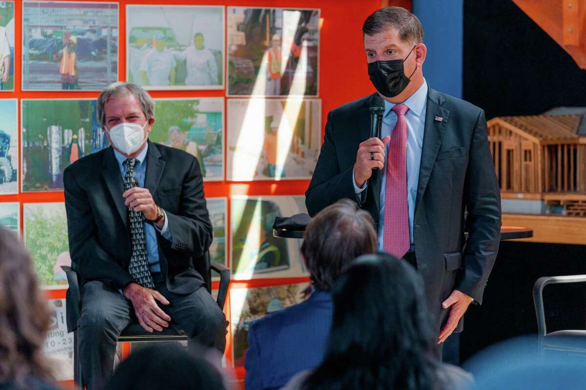 U.S. Rep. Mark DeSaulnier (left) and U.S. Secretary of Labor Marty Walsh address the audience during an event at RichmondBUILD.