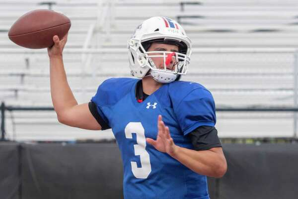 Midland Christian's Ryver Rodriguez looks to pass as he and other players run drills 08/11/2021at Gordon Awtry Field. Tim Fischer/Reporter-Telegram
