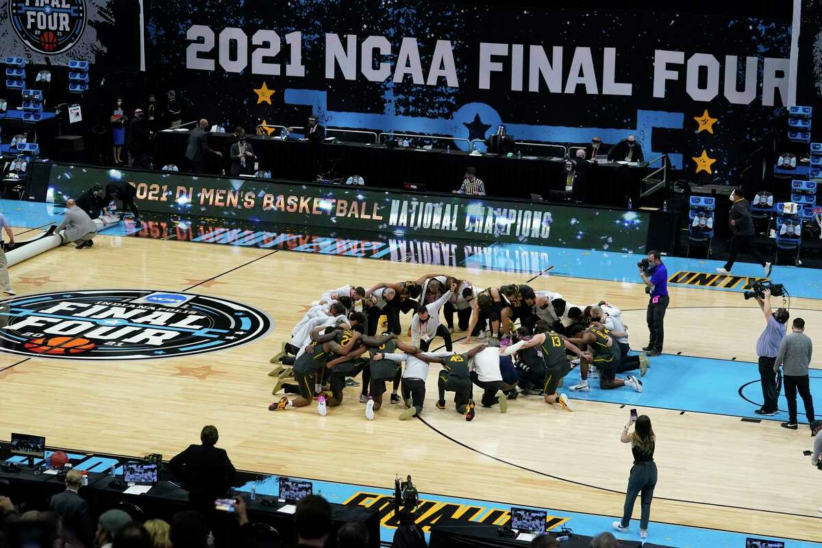 Baylor players huddle on the court at the end of the championship game against Gonzaga in the men's Final Four NCAA tournament in Indianapolis on April 5, 2021.