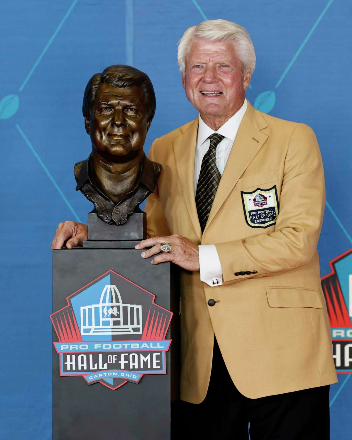 Jimmy Johnson, a member of the Pro Football Hall of Fame Centennial Class, poses with a bust of himself during the induction ceremony at the Pro Football Hall of Fame, Saturday, Aug. 7, 2021, in Canton, Ohio. (AP Photo/Ron Schwane, Pool)