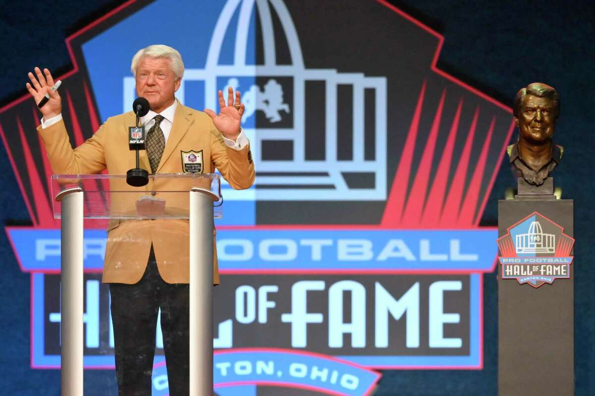 Jimmy Johnson, a member of the Pro Football Hall of Fame Centennial Class, speaks during the induction ceremony at the Pro Football Hall of Fame, Saturday, Aug. 7, 2021, in Canton, Ohio. (AP Photo/David Richard)