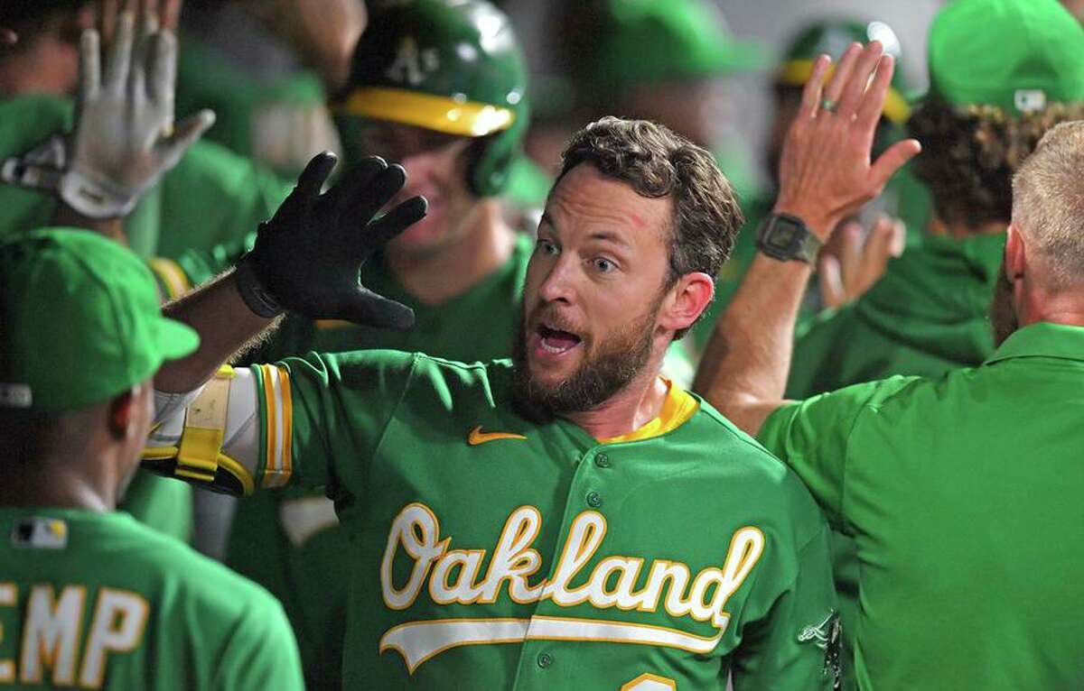 Jed Lowrie celebrates after hitting a three-run homer in the eighth inning to give the A's a 6-3 victory over the Indians.