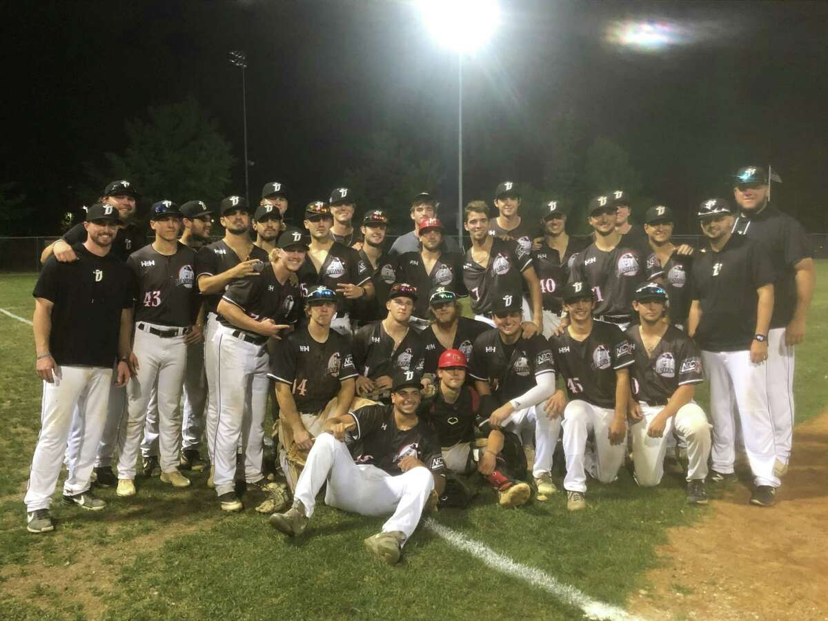 The Danbury Westerners celebrate their 13-5 win over the North Shore Navigators in the NECBL championship series on Wednesday, Aug. 11, 2021 at Rogers Park in Danbury, Conn.