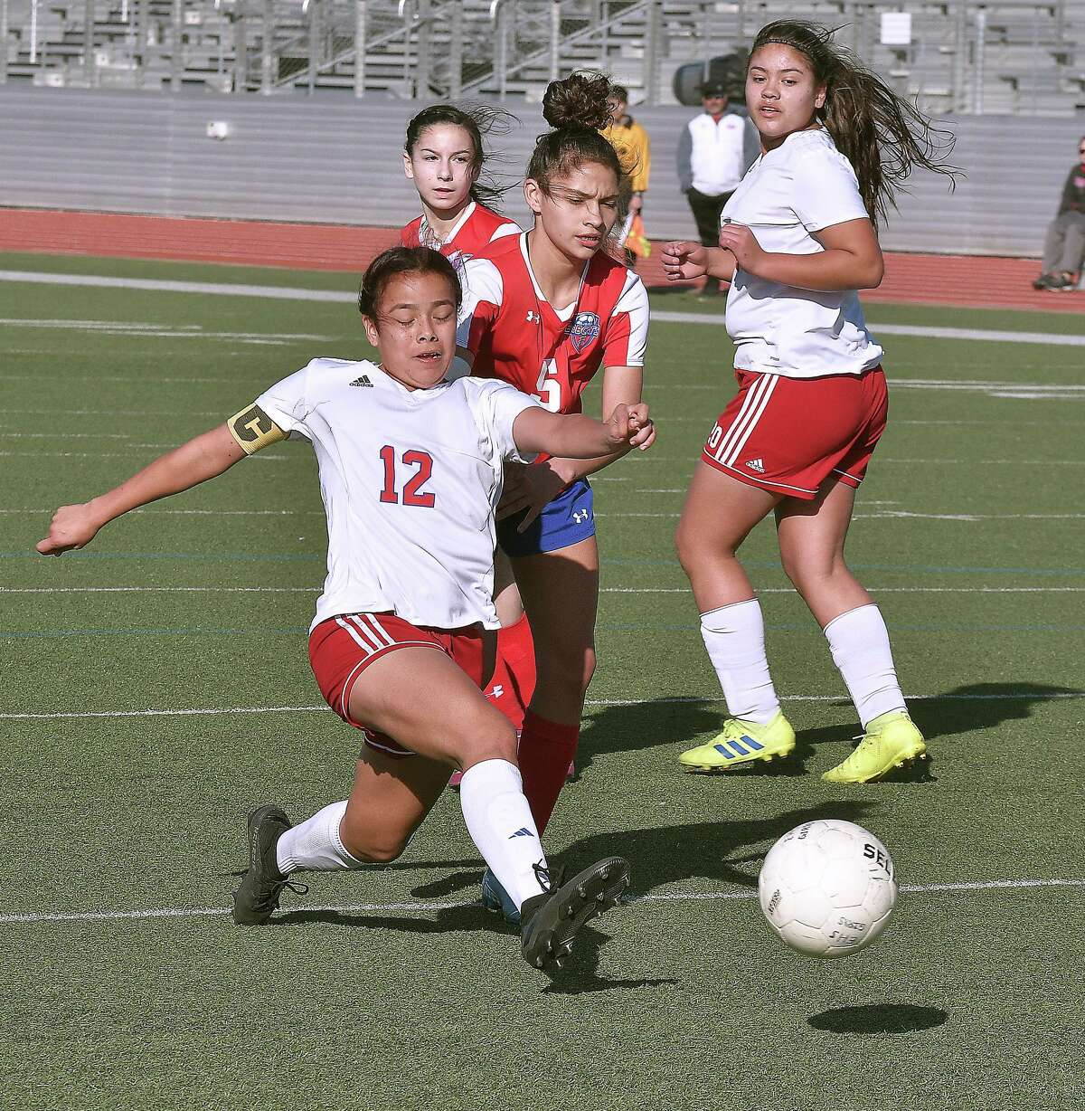 Jackeline Torres gets a shot on goal for Martinin the Border Olympics girls' soccer tournament on Friday, Jan. 3, 2020 at Shirley Field.