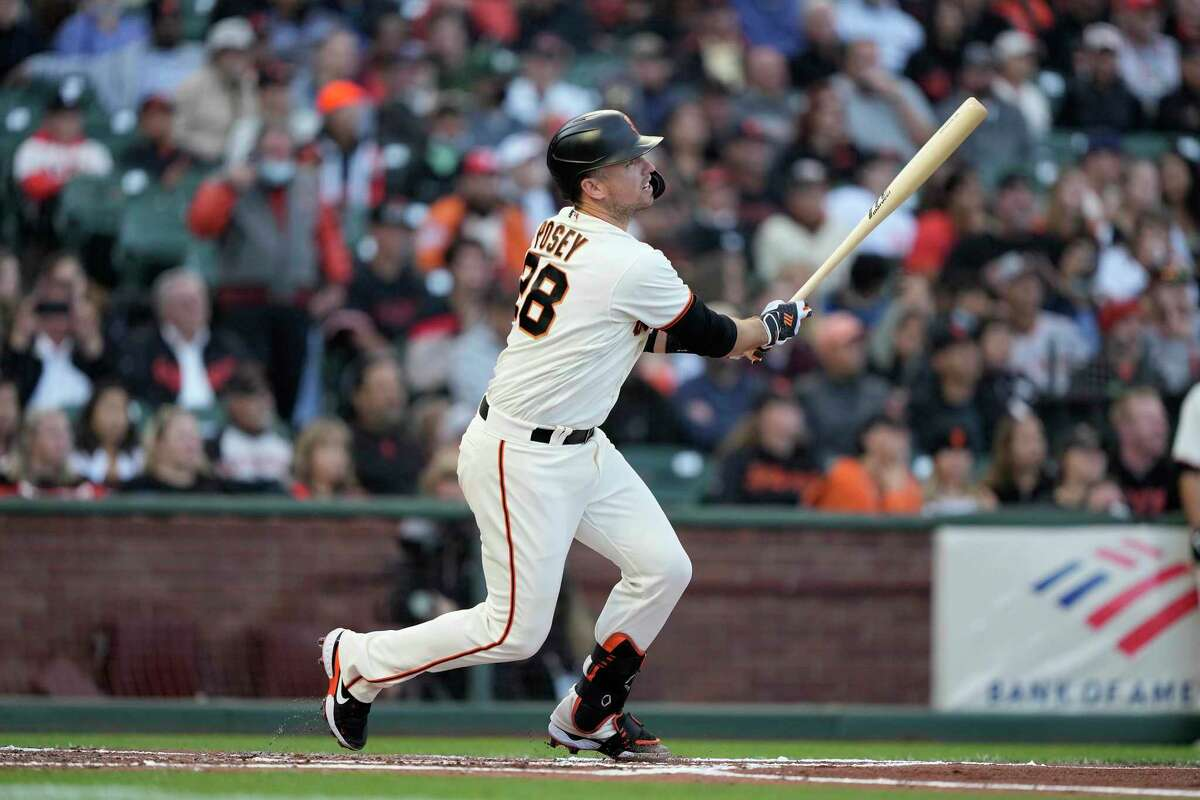 San Francisco Giants' Buster Posey hits a single against the Arizona Diamondbacks during the first inning of a baseball game Wednesday, Aug. 11, 2021, in San Francisco. (AP Photo/Tony Avelar)