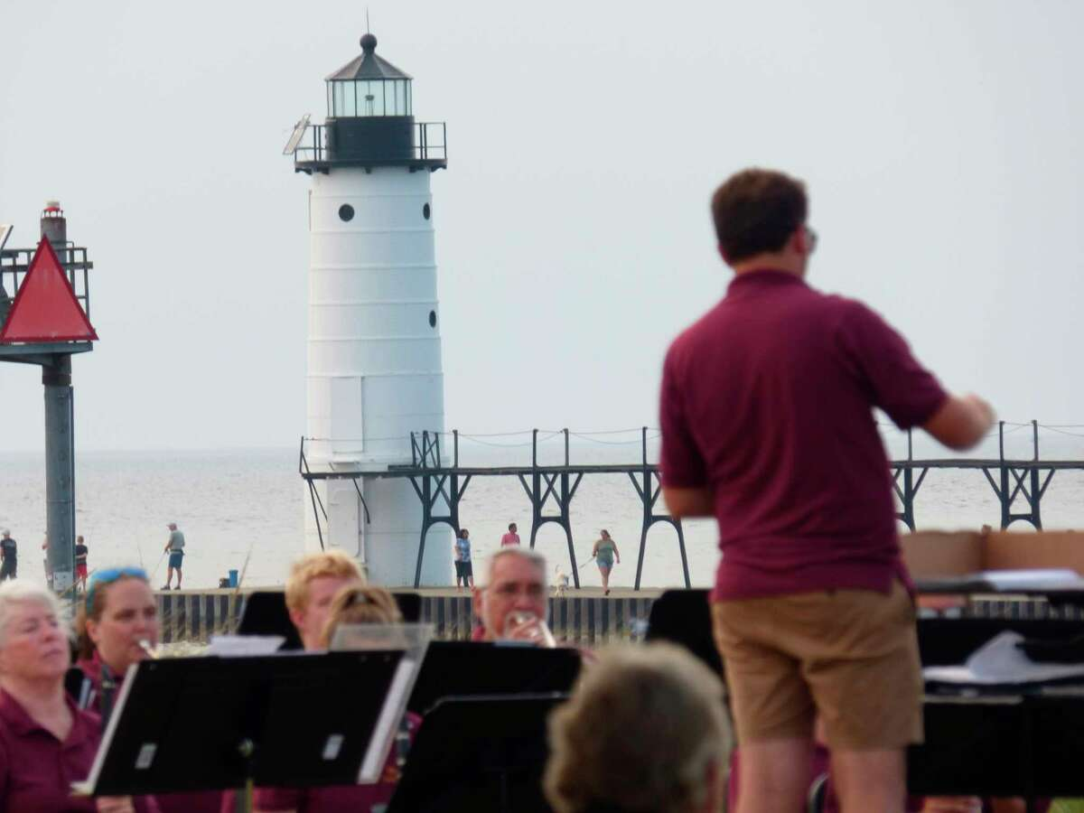 The Manistee Community Band performs the last song of its summer concert series on Aug. 10 at First Street Beach in Manistee. (Scott Fraley/News Advocate)