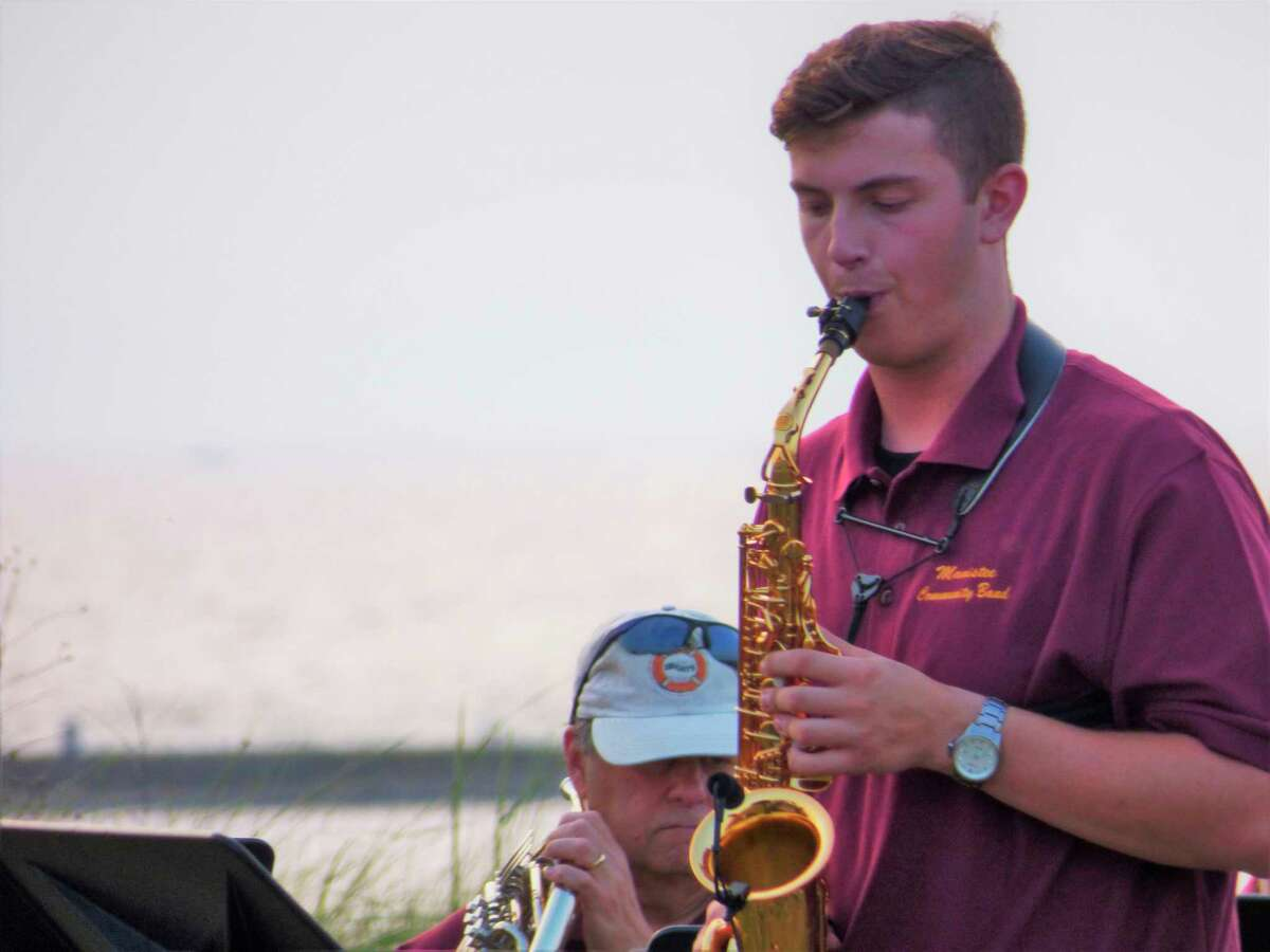 Jacob Bissonnette performs a saxophone concerto at a Manistee Community Band concert on Tuesday. Bissonnette is a Central Michigan University music student and resident of Flushing. (Scott Fraley/News Advocate)