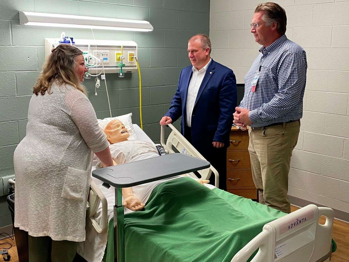 Director of Nursing and Allied Health Shelley Boes , WSCC President Scott Ward, and Spectrum Health Ludington Hospital President Drew Dostal view a high-fidelity manikin while touring the facility. (Submitted photo)