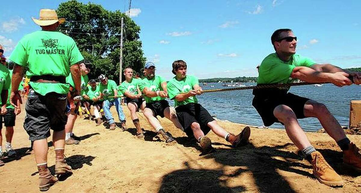 Competitors pull their end of the rope during a Tug Fest competition between teams in the Illinois city of Port Byron and LeClaire, Iowa.