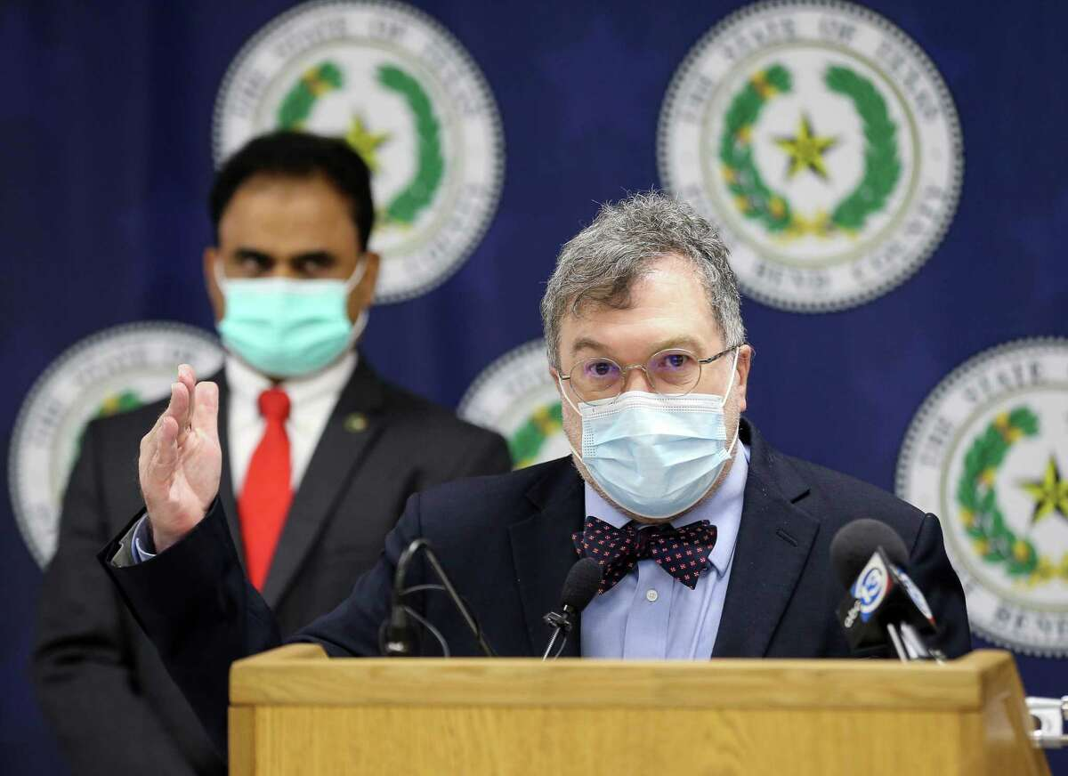 Co-director of the Center for Vaccine Development at Texas Children's Hospital Dr. Peter Hotez, center, talked to reporters during a press conference in which Fort Bend County Judge KP George indicated the COVID-19 risk level has been increased for the county, on Tuesday, Aug. 3, 2021, in Richmond.