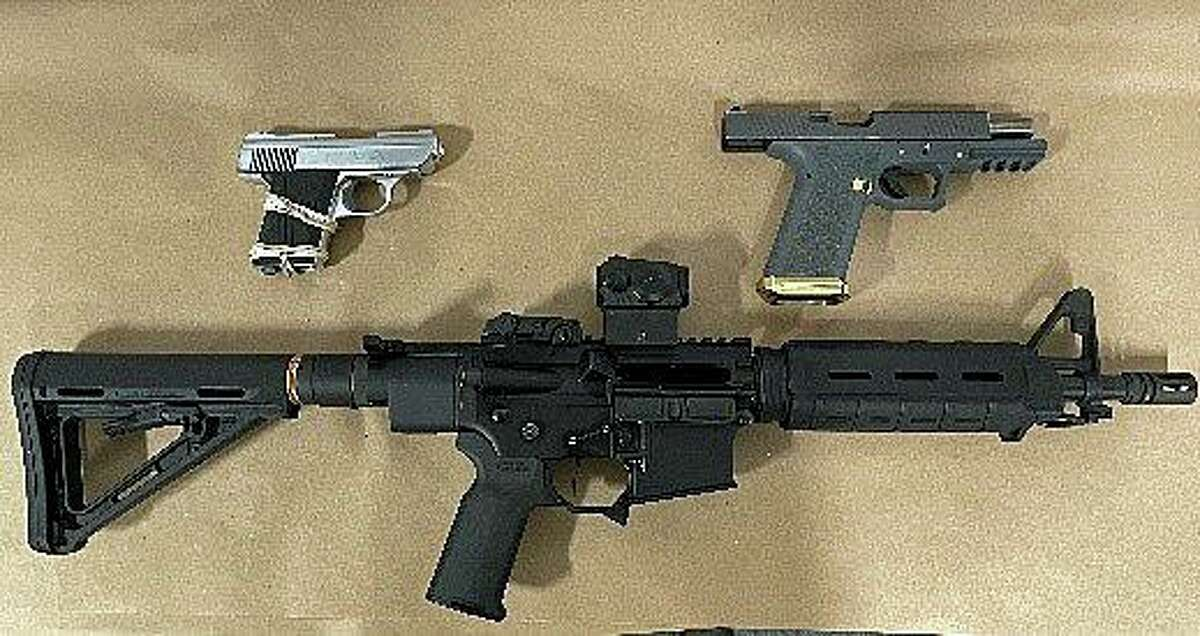 The guns seized from a Plainfield, Conn., home on Wednesday, Aug. 11, 2021.