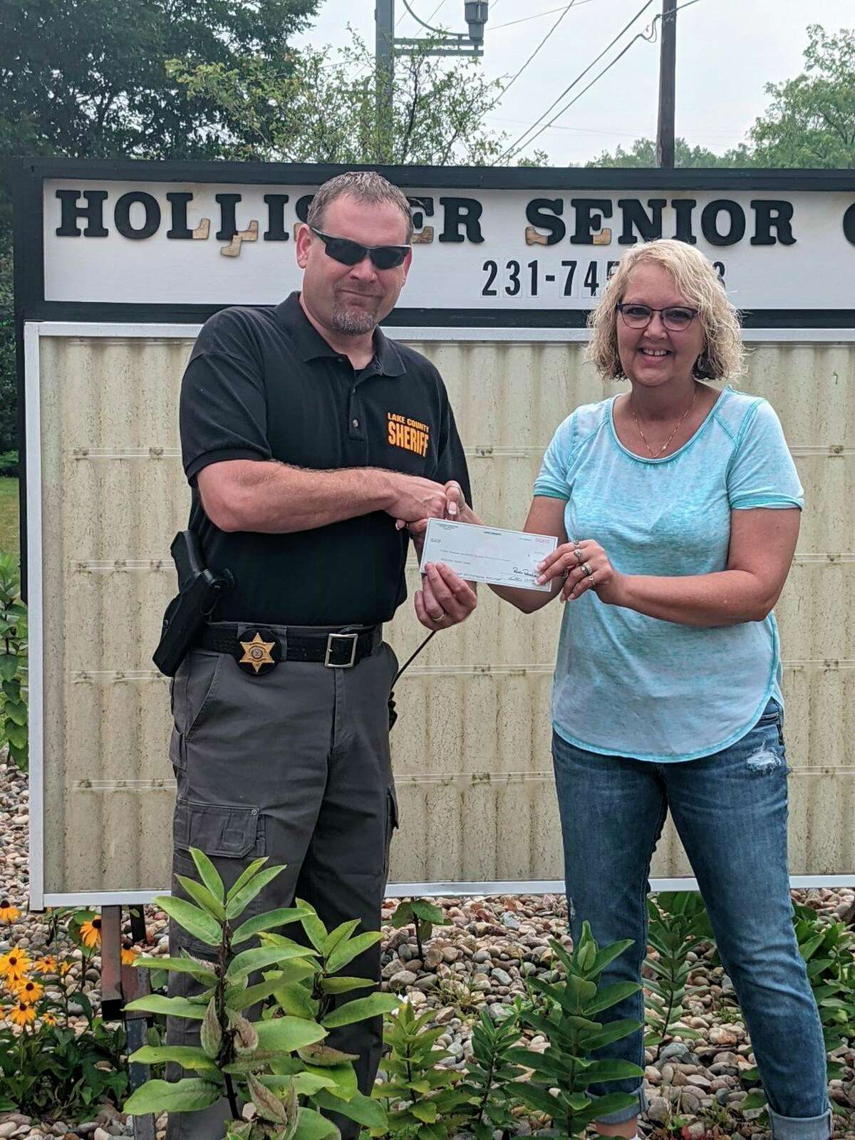 Lake County Sheriff Rich Martin presented Cheri Davidson, with the Hollister Center, with a check for $2000 from the Sheriff's department charitable campaign. (Submitted photo)