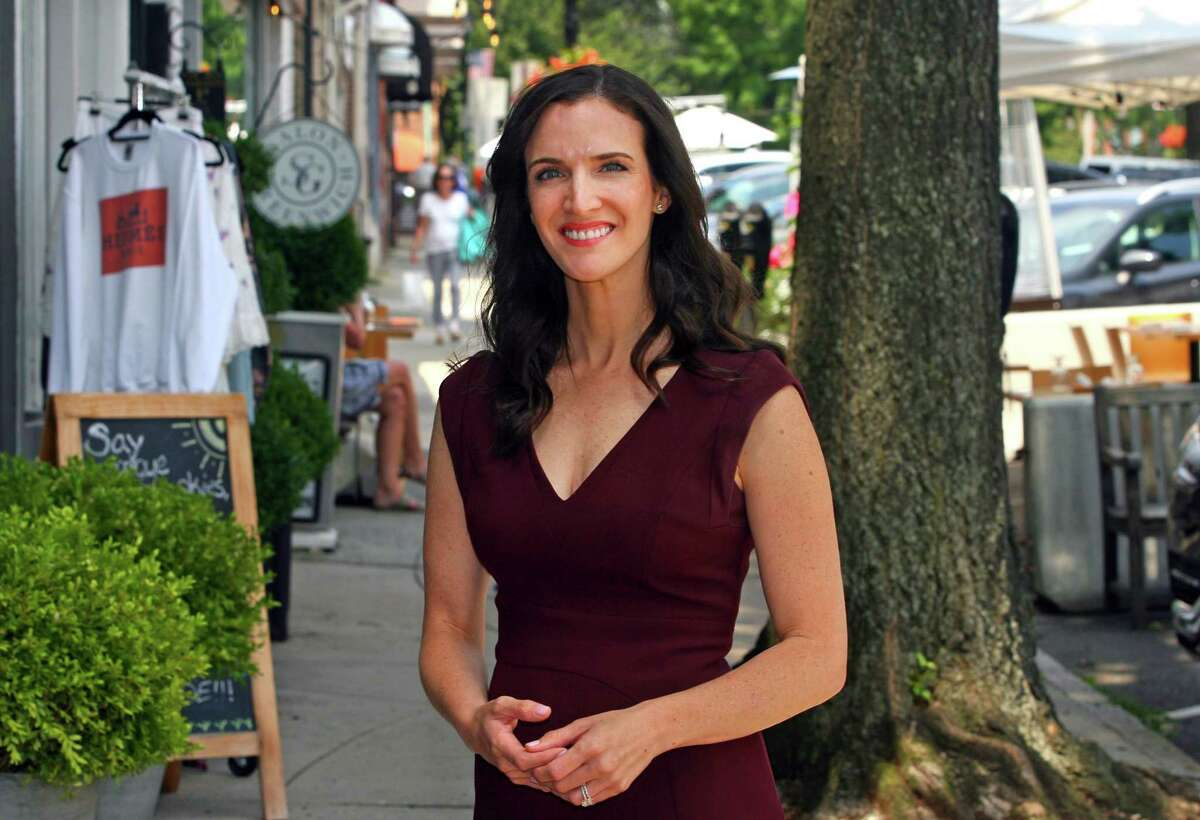 Alexis Gevanter, a Democratic candidate for state Senate, poses along Greenwich Avenue in Greenwich, Conn., on Wednesday July 28, 2021.