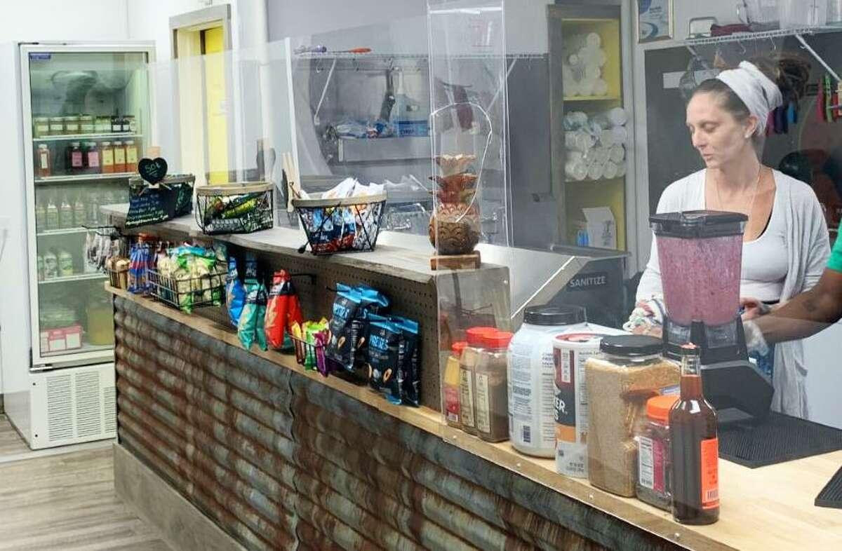 Middletown CleanHeart juice bar co-owner Jillian Webber serves customers at the 80 Washington St. shop.