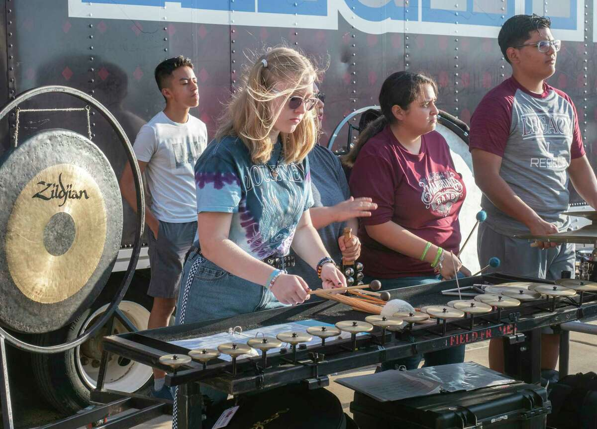 Members of the Legacy High marching band percussion practice together 08/12/2021 in front of the newly wrapped semi that carries equipment to games. Tim Fischer/Reporter-Telegram