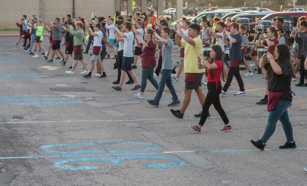 Legacy High marching band members work on their steps 08/12/2021, on a partially painted area of the parking lot outside LHS. Tim Fischer/Reporter-Telegram