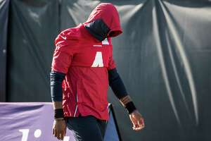 Houston Texans quarterback Deshaun Watson walks to the field during an NFL training camp football practice Wednesday, Aug. 11, 2021, in Houston.