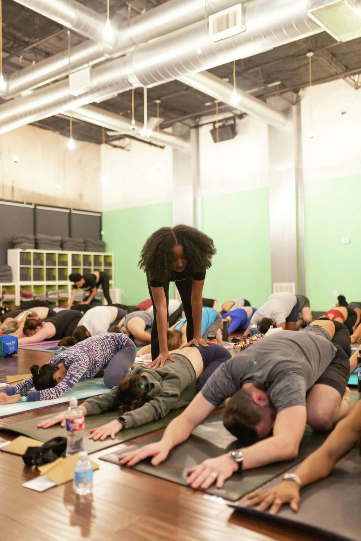 Yoga instructor, healer, and entrepreneur Jazmin Porter leads an initiative that teaches yoga and mindfulness to Houston Police officers. Photo from previous course not with HPD.