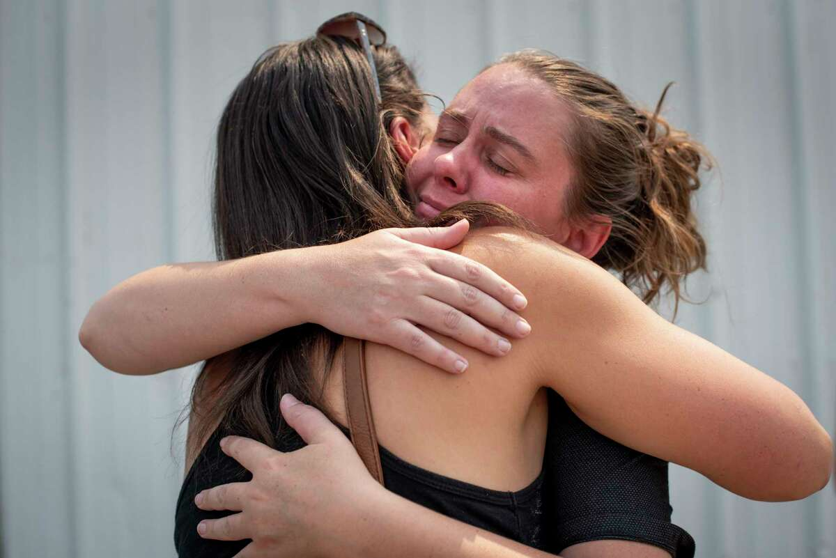 Fairbanks, left, embraces her friend Ellie Hatch at an American Red Cross shelter in Quincy, Calif., on Aug. 10.