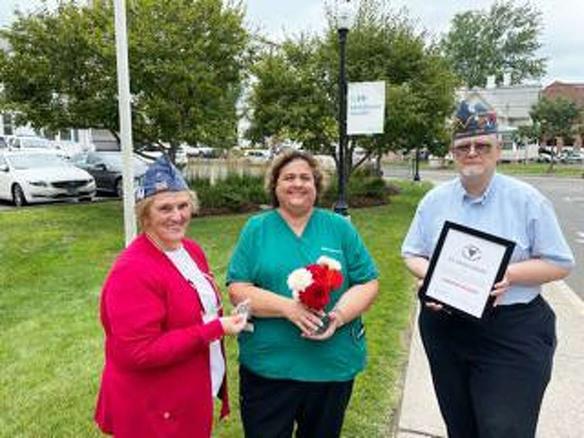 """The Clinton branch of the Forty and Eight Society of American veterans and service members gave its """"Grand Award"""" to respiratory therapist Jennifer McLeod, center, Tuesday at Middlesex Hospital in Middletown. At left is state Senior Vice President Train Eileen Richard, and, at right, state Secretary Frazier Brinley."""