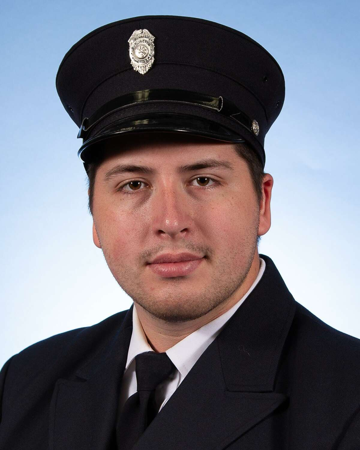 Burlington firefighter and EMT Colin McFadden, 26, suffered a medical emergency while fighting the New Hartford House fire Aug. 10. He died Thursday, officials said.