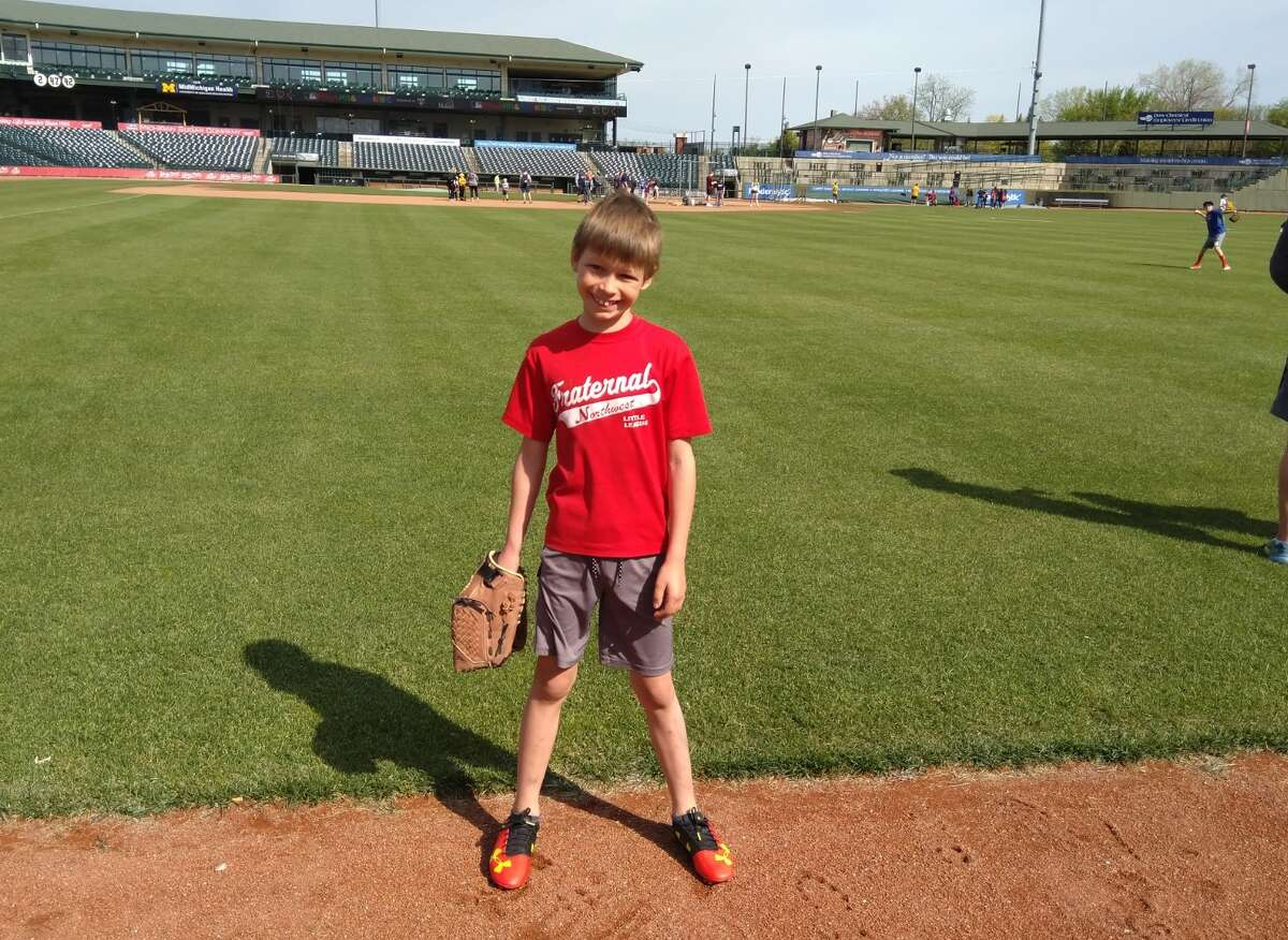 Midland's Grayson Skorup poses at Dow Diamond during the May 15, 2021 Pitch, Hit and Run local competition.